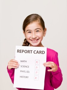 Happy Student with Good Report Card