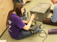 Spectrum team members working on the prototype for the 2015 robot